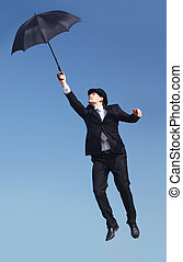 Flight - Photo of businessman flying on umbrella with blue...
