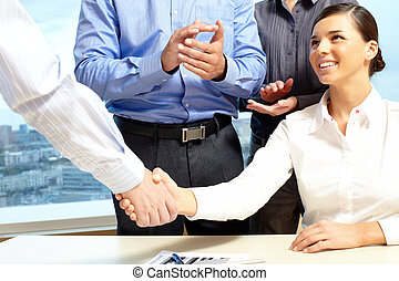 Agreement - Image of business handshake after making an...