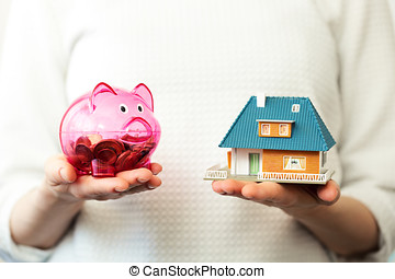 savings for new family house concept - piggy bank and house...