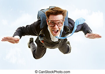 In the sky - Conceptual image of young businessman flying...