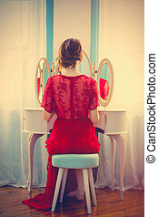 young woman near console mirror - portrait of beautiful...