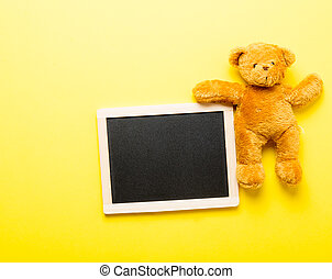 blackboard and teddy bear - photo of empty blackboard and...