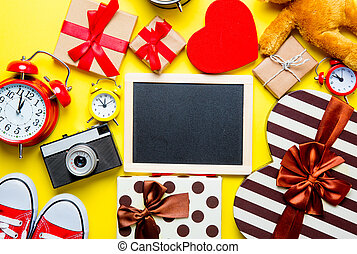 gifts, blackboard, alarm clocks, camera, teddy bear - photo...