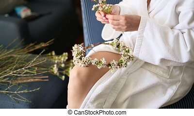 The bride in a white hotel gown wove wreath gypsophila
