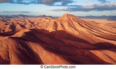 Flight over desert landscape, Fuerteventura island, Spain -...