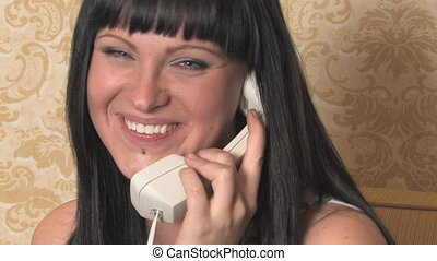 Young woman laughing on phone.