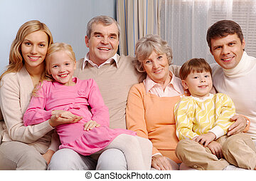Family at home - Portrait of senior and young couples with...