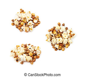 Pile of semi-cooked popcorn kernels isolated over the white...