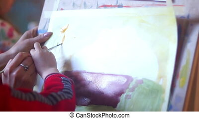 Woman artist paint draw - Woman and children artist painting...