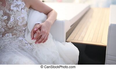 The newlyweds hold hands on the boat. Couple holding hands....