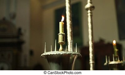 Candles in the church on the altar. Orthodox Church in...