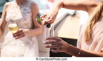 Champagne is poured into a glass.