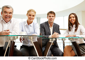 Business seminar - Image of confident business team sitting...