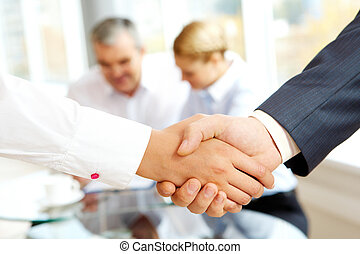 Agreement - Close-up of business people making agreement in...