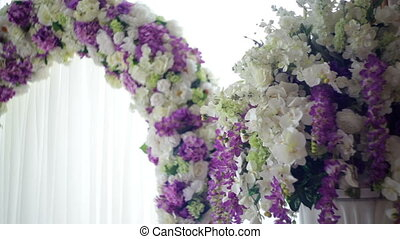 Beautiful wedding arch for the ceremony of flowers.