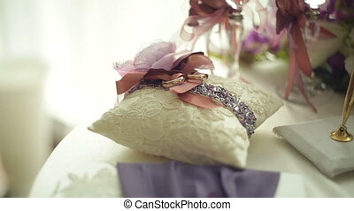 Table for a wedding ceremony with glasses of champagne, rings and a bouquet of flowers