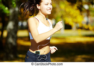 Positive runner - Portrait of a young woman jogging with a...