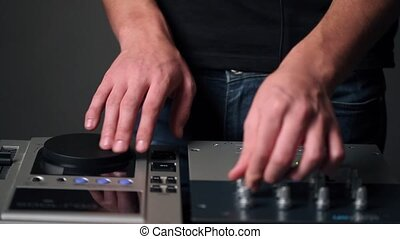 DJ man hands make music - DJ man hands activity close up