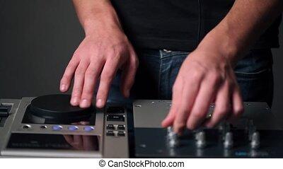 DJ man hands make music - DJ man hands activity close up