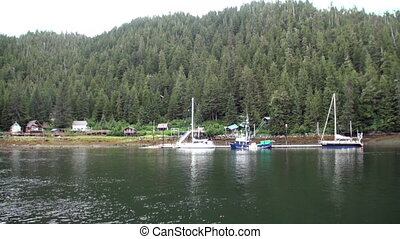 Yachts pier on background of landscape calm water of Pacific Ocean in Alaska.
