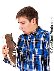 Young Man with a Sneaker - Young Man feel a stinking smell...