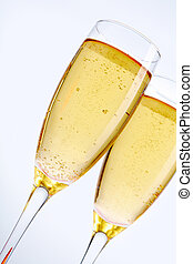 Glasses with champagne - two glasses with champagne isolated...