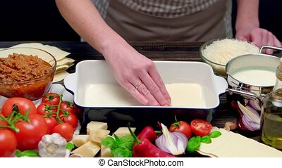 Preparation of homemade lasagna. Italian pasta recipe with...