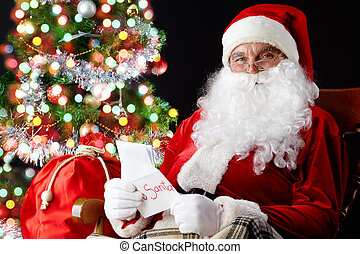 Christmas letters - Santa sitting at the Christmas tree,...