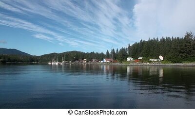 Yachts pier on background of landscape calm water of Pacific...