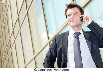 Busy entrepreneur - Portrait of successful young man calling...