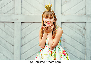 young little 9-10 year old girl, wearing beautiful dress and...