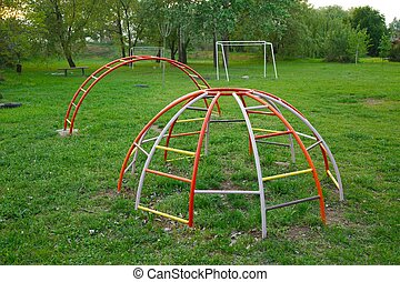 Monkey bars on a playground - Colorful monkey bars on an old...