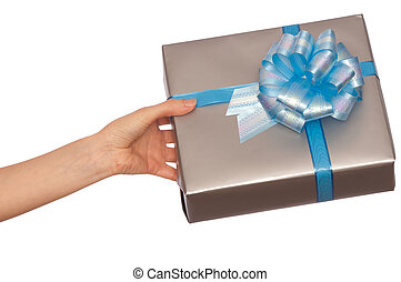 present - woman giving a silver box with blue bow as a gift