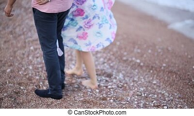 Couple on the beach in Montenegro. Newlyweds are walking on the