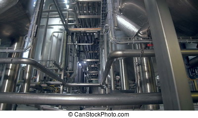 The factory pipeline and tanks. Dolly. 4K. - The plant's...