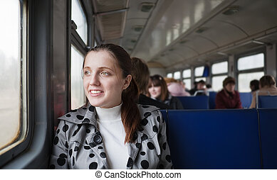 woman passanger sitting inside train - Photo of young woman...