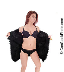 Slim woman in black lingerie and jacket.
