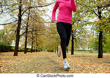 Autumn run - Girl running among autumn trees