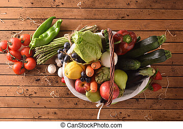 Fruits and vegetables on wood table top view - Assortment of...