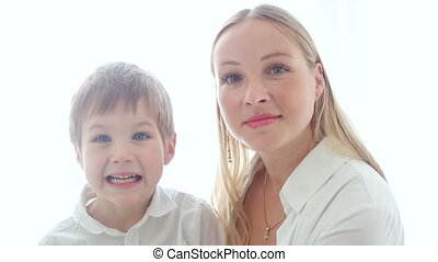mother and son sitting at home exciting