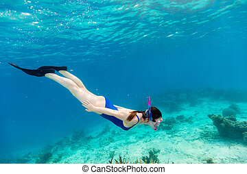 Woman snorkeling - Underwater photo of woman snorkeling in a...