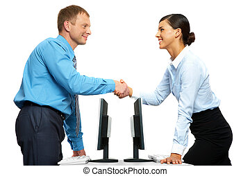 Successful collaboration - Two businesspeople shaking hands...