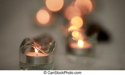 the white candle is lit on a white background