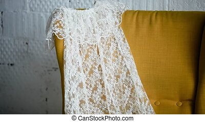 white wedding dress lying on the bed