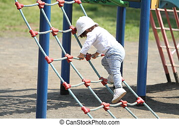 Japanese girl playing with rope walking (1 year old)