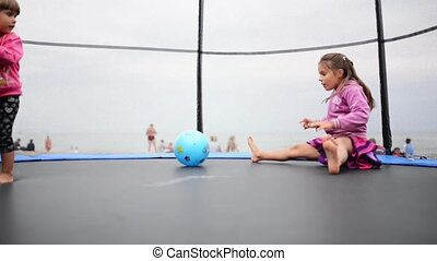 Baby girls at trampoline - Happy children playing at...