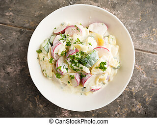 potato salad - fresh potato salad with radish and cucumber