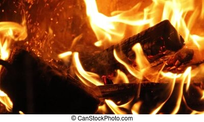 Flames of a fireplace - Burning fire, moving the logs around...