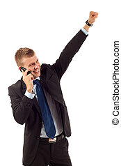 winning on the phone - happy business man with cellular...