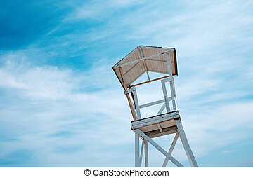 Beach stand on blue sky background - Wooden beach stand on...